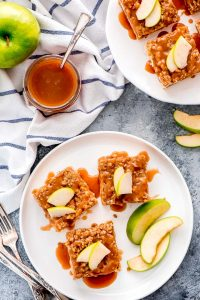 With layers of short bread crust, cheesecake, apples, streusel, and caramel drizzle, Caramel Apple Cheesecake Bars are the perfect fall dessert.