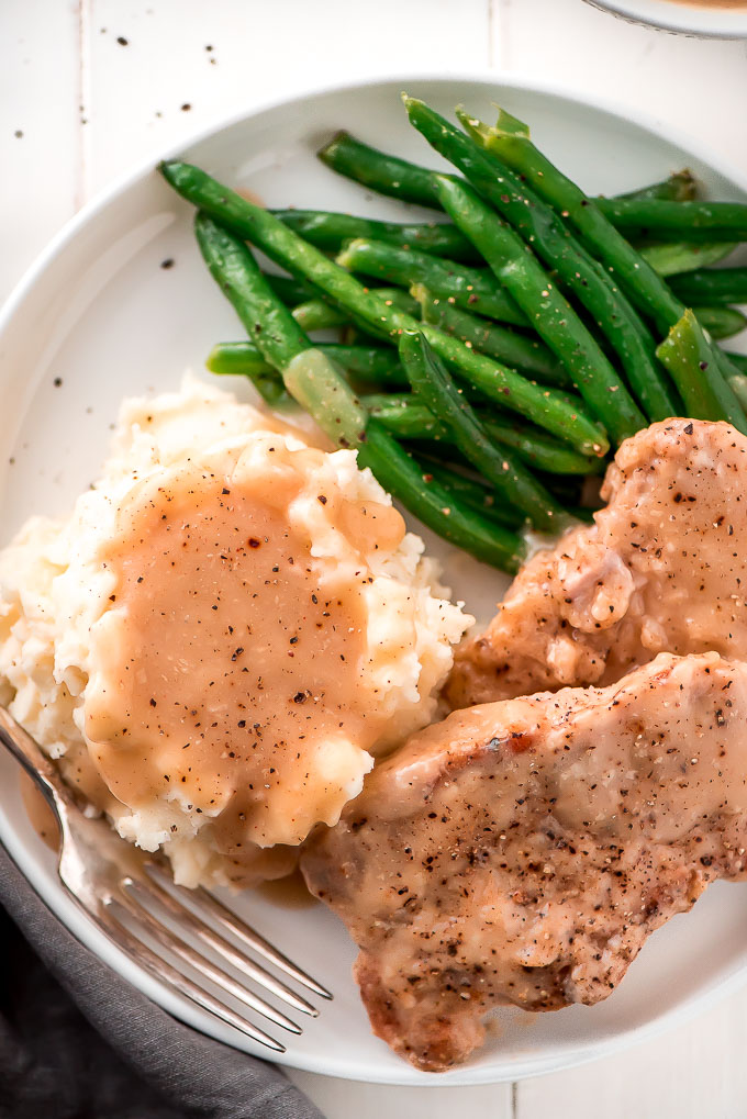 These Super Tender Slow Cooker Pork Chops And Gravy Take Just 10 Minutes To Prep