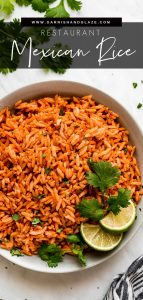 A bowl of Spanish Rice garnished with cilantro and lime wedges on the side.