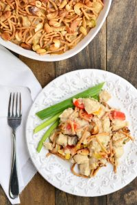 Creamy Cashew Chicken Casserole filled with rice, chicken, bell peppers, and topped with crunchy chow mein noodles and cashews
