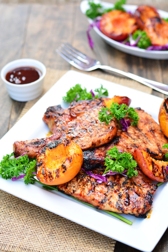 barbecue pork chops with grilled peaches  garnish  glaze