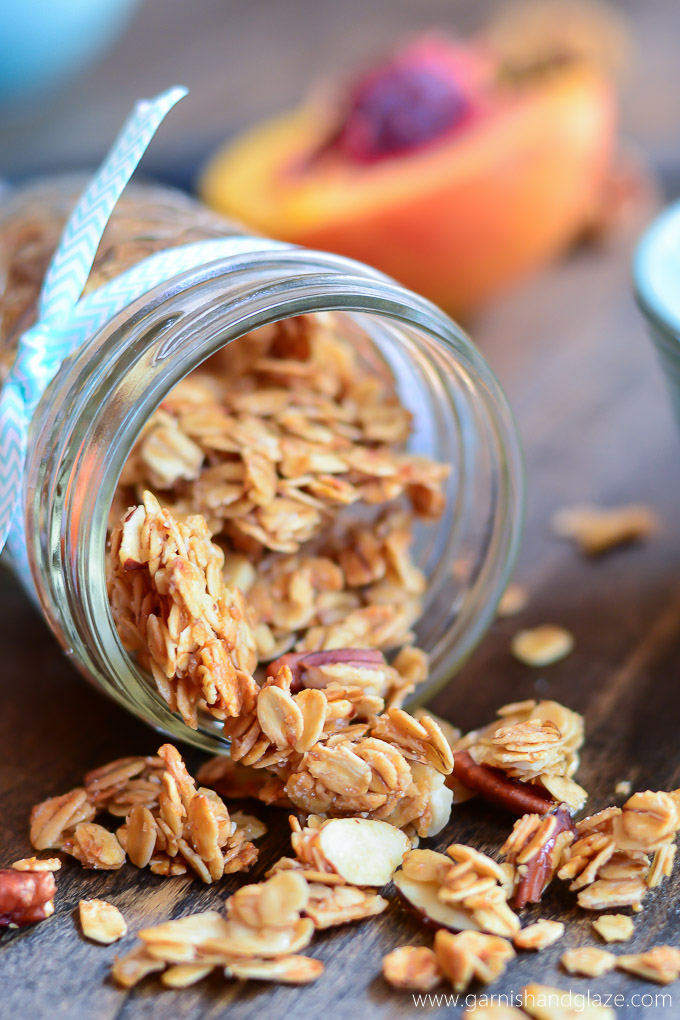 Crunchy homemade vanilla granola with almonds and pecans is the perfect snack to munch on or throw in your yogurt.