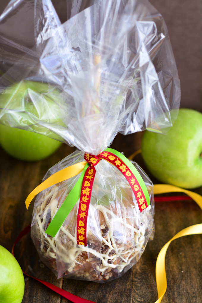 Caramel Apple packed up in cellophane and tied with ribbon.
