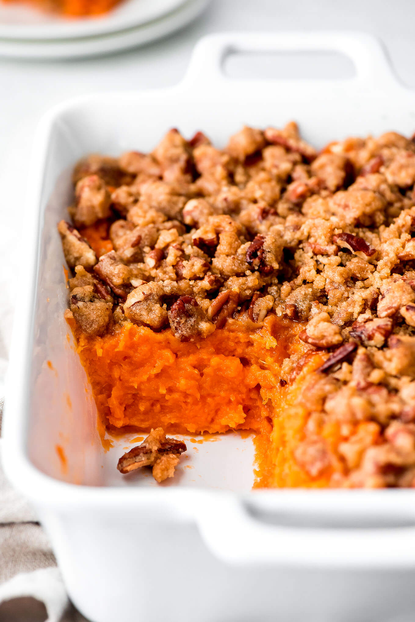 Closeup of sweet potatoes and sugar pecan crumb topping.