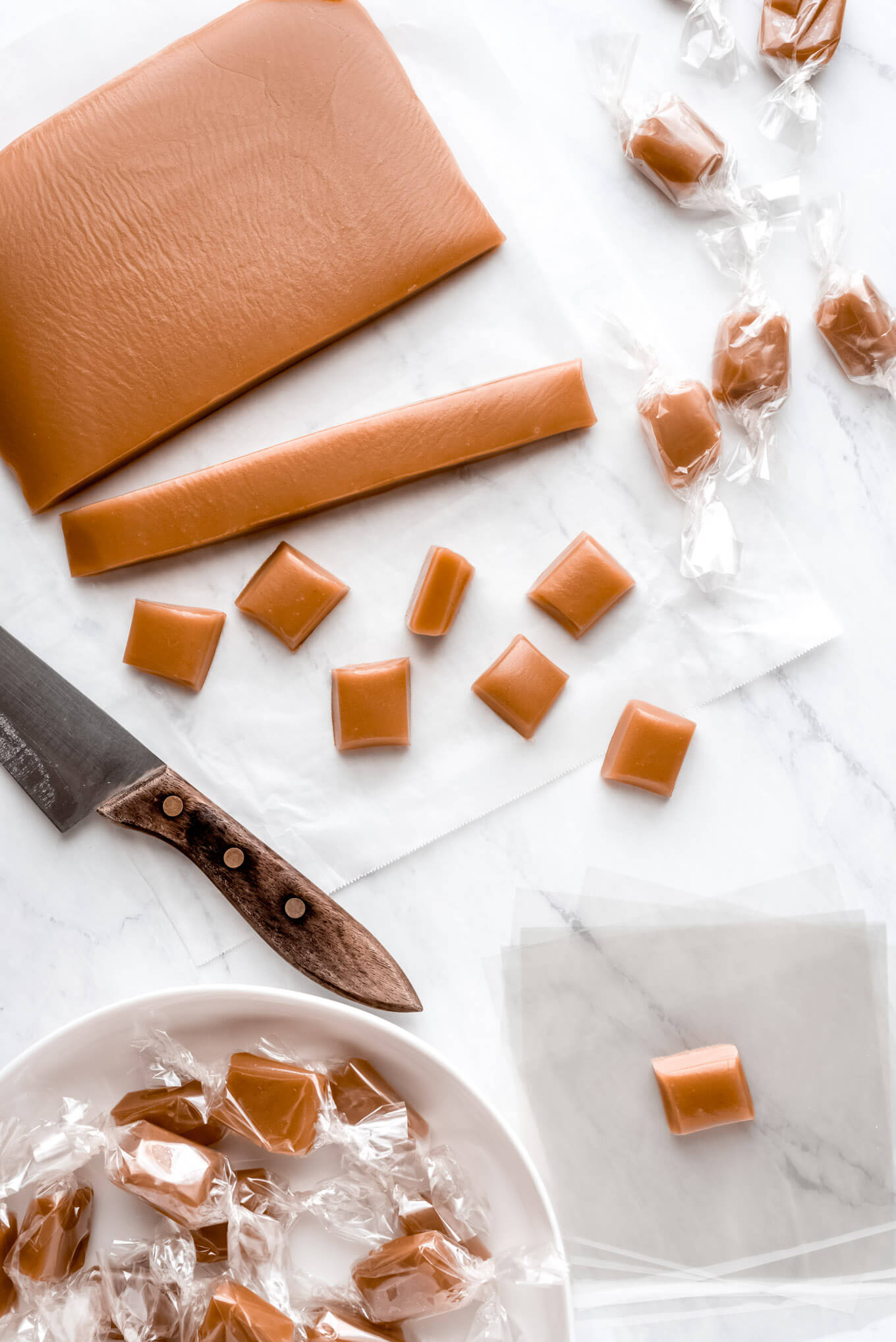 Cutting up and wrapping homemade caramels.