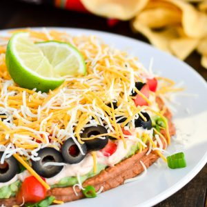 Mexican Layered Dip is the perfect crowd pleasing appetizer for any party.