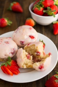 Glazed Strawberry Muffins- Soft and tender muffins filled with fresh strawberries and dipped in a sweet strawberry glaze | Garnish & Glaze