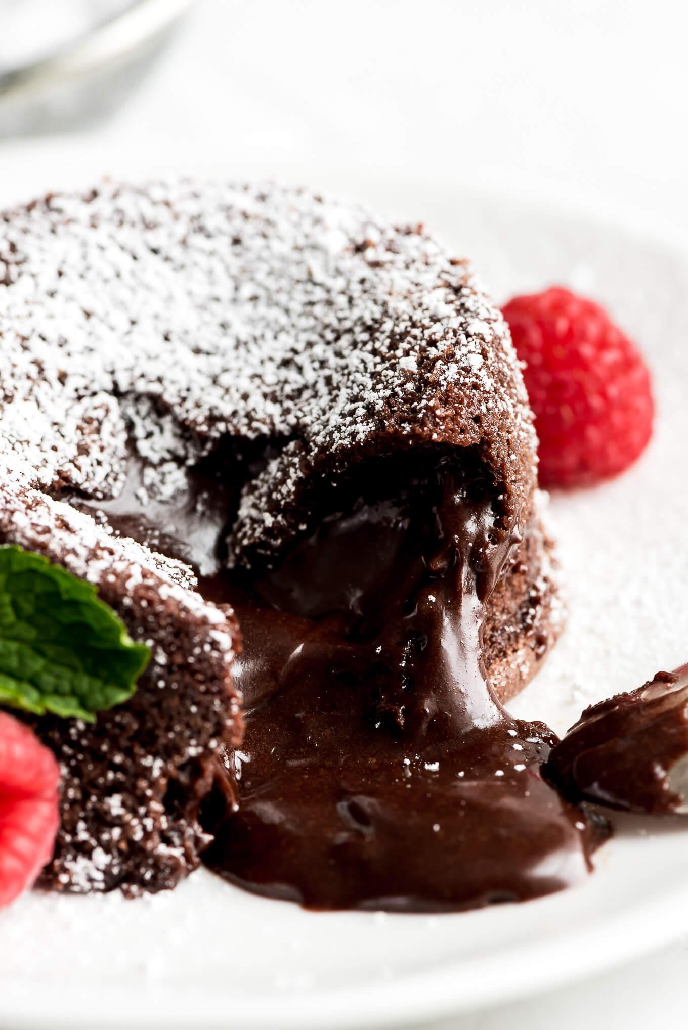 A closeup shot of the gooey chocolate center of a molten lava cake.
