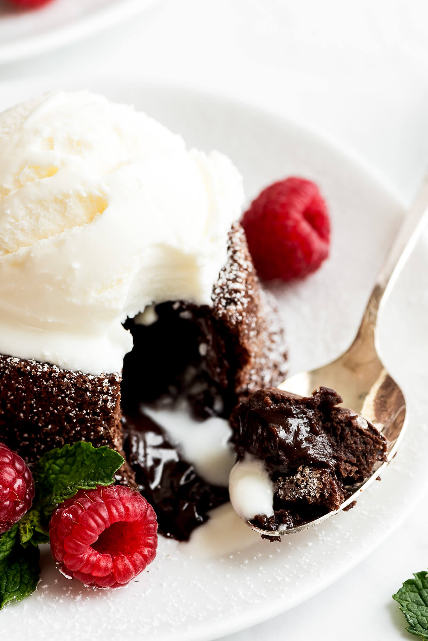 A closeup shot of a spoonful of chocolate Molten Lava Cake.