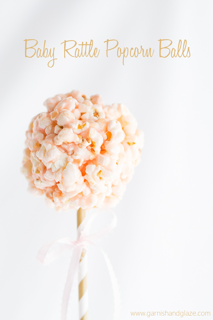 Popcorn balls made to look like baby rattles. Perfect for a baby shower!
