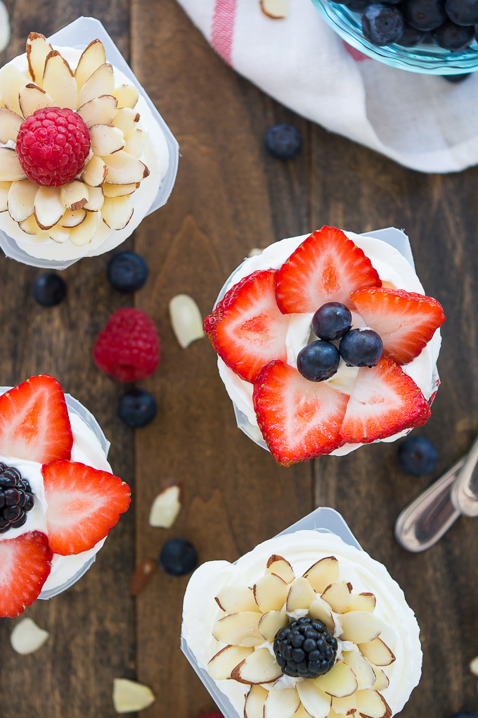 Fresh fruit mixed into vanilla Snack Packs and topped with an arrangement of berries and almonds in the shape of a flower. #SnackPackMixins #Ad