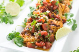 Grilled chipotle chicken topped with pico de gallo made with Hunts Fire Roasted Tomatoes