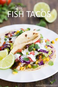 Tacos filled with spiced pan-seared tilapia, cabbage, lettuce, corn, and pico de gallo