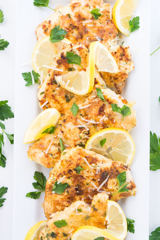 This pan-seared, moist and tender Chicken Francais topped with a buttery lemon sauce makes for a light and refreshing summer chicken dinner.