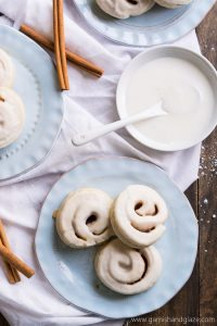 Cinnamon and sugar rolled up in sugar cookie dough and then iced to create Cinnamon Roll Cookies.