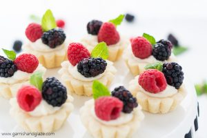 Mini Berry Tarts are perfectly portioned tarts with a tender crust, sweet creamy filling, and topped with beautiful fresh berries.