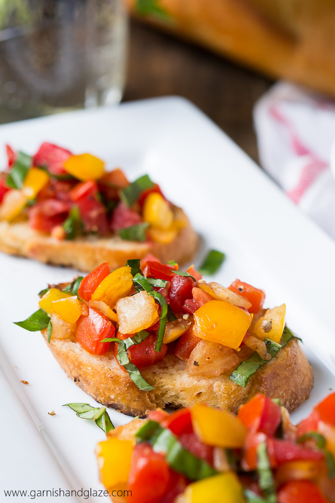 Tomato Basil Bruschetta made with home grown tomatoes, ribbons of basil, and a bit of balsamic vinegar served on buttery toasted French bread.