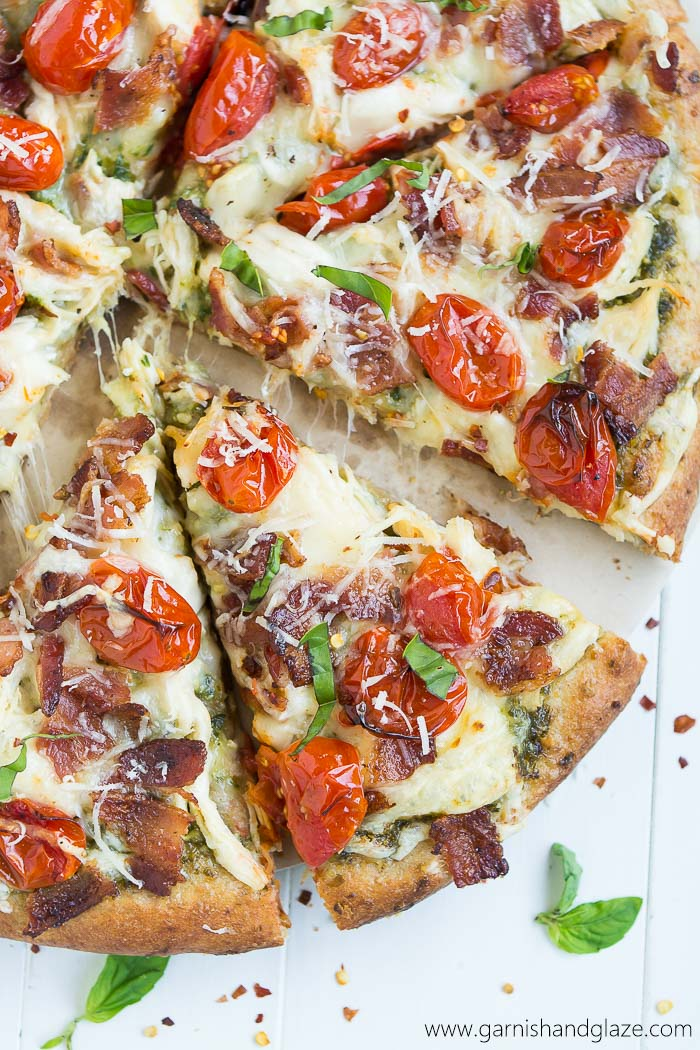 Chicken, Bacon, Pesto Pizza with blistered grape tomatoes.