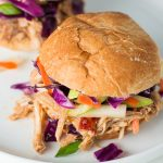 For an easy dinner or Game Day treat, pull out your slow cooker for these flavorful Apple Bourbon Pull Pork Sliders with Apple Slaw.