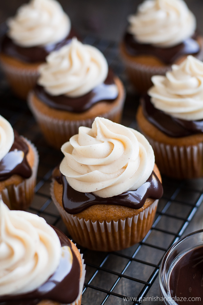 A perfectly moist pumpkin cupcake covered in rich chocolate ganache and topped with cinnamon cream cheese frosting.