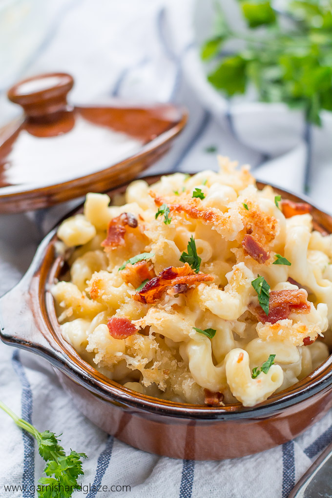5 Cheese Mac & Cheese in a small round dish topped with extra cheese, crispy Panko bread crumbs, and bacon.