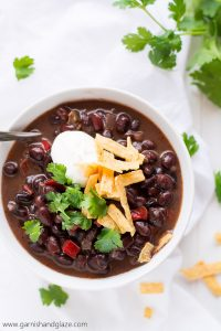Cozy up this fall with a warm bowl of this flavorful, high protein, high fiber, vegan Black Bean Soup.