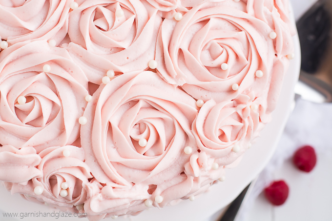 raspberry rose cake is made up of two tender white cakes with sweet raspberry jam sandwiched