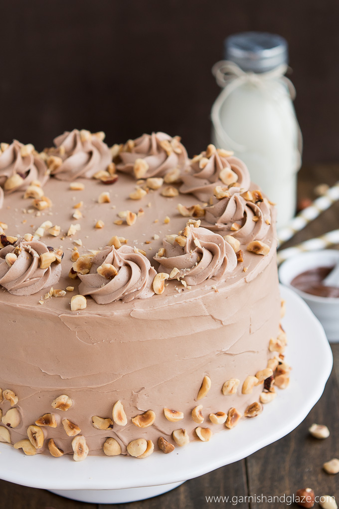 Banana Hazelnut Cake is a flavorful tender banana cake covered in silky smooth Nutella frosting.