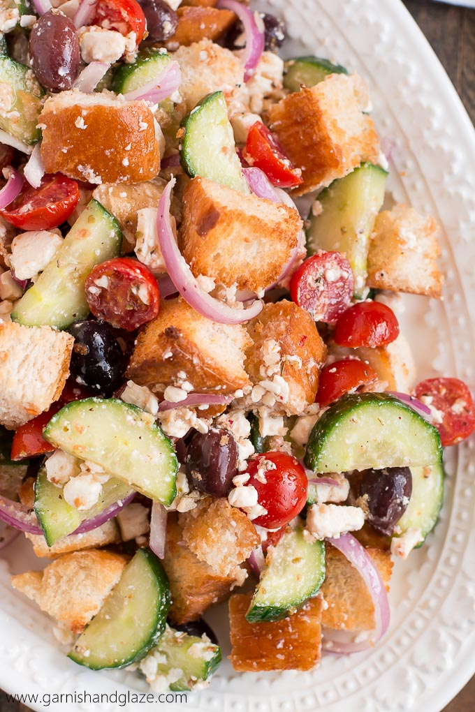 Make Greek Panzanella to use up your leftover French bread in this veggie filled summer salad.