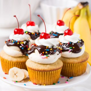 Delight in the delicious flavors of your favorite ice cream dessert in these Banana Split Cupcakes topped with smooth buttercream, rich ganache, cream, and a cherry on top.