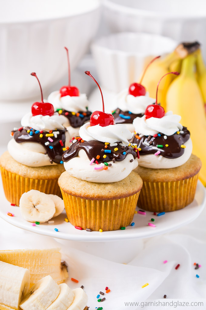 Delight in the delicious flavors of your favorite ice cream dessert in these Banana Split Cupcakes topped with smooth buttercream, rich ganache, and a cherry on top.