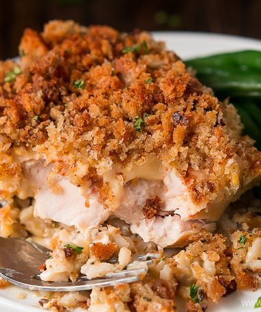 Chicken & Wild Rice Casserole is the ultimate comfort food layered with flavorful rice, chicken, a cheesy sauce, and crispy stuffing.
