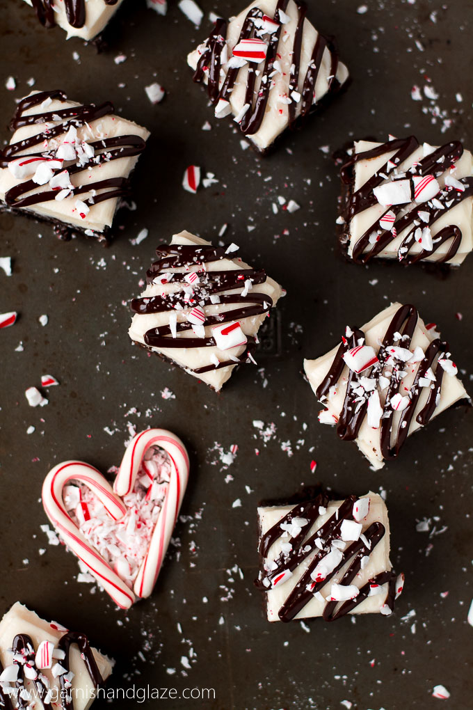 Enjoy the holidays with these rich dark chocolate Cream Cheese Peppermint Brownies topped with a delicious cream cheese frosting, ganache, and crushed candy cane.