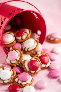 It takes just three ingredients to throw together these perfectly cute, extremely easy, and super yummy Valentine Pretzel Hugs.