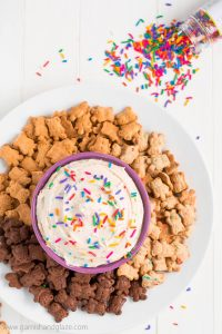 Make FUNFETTI DUNKAROO DIP and you'll be eating the most coveted snack in a kid's lunch... back in the 90's. Who else was dunking cookies in frosting at the lunch table???