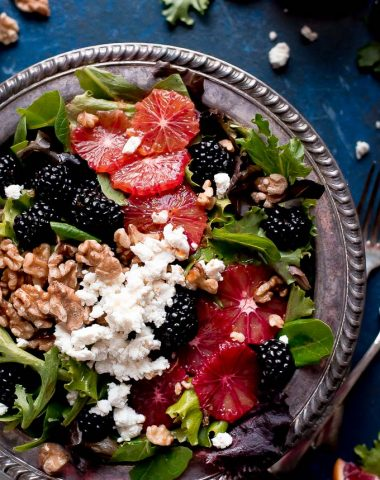 Grab a bowl of this BLACKBERRY BLOOD ORANGE SALAD with blood orange vinaigrette, creamy goat cheese, and toasted walnuts. Eating healthy never tasted so good!