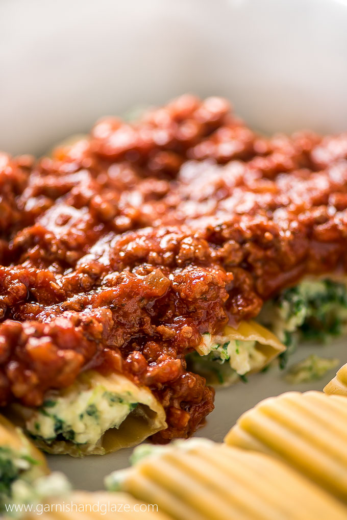 Hard noodles filled with cheese and topped with a hearty meat red sauce.