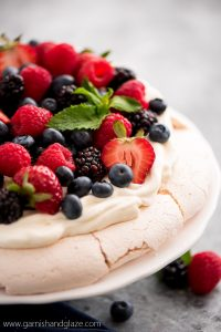 Mixed Berry Pavlova is the perfect summer party dessert! It's simple, beautiful, refreshing, and a definite crowd pleaser.