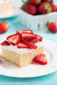 For a sweet, cool, and refreshing summer party dessert, whip up this Strawberry Topped Tres Leches Cake. Cake never tasted so good!