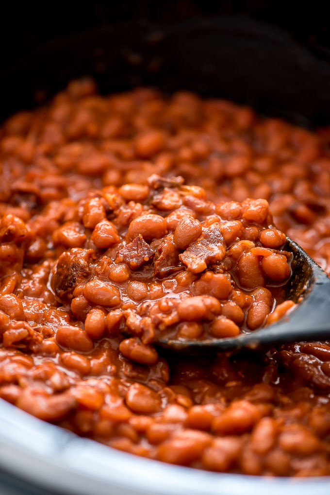 Slow Cooker Baked Beans are a delicious and easy made-from-scratch side dish that tastes fantastic next to your favorite burger.