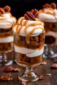 Dig in to one of these heavenly Mini Caramel Pecan Pumpkin Cheesecake Trifles layered with rich brown sugar caramel, toasted pecans, cheesecake filling, and moist pumpkin cake.