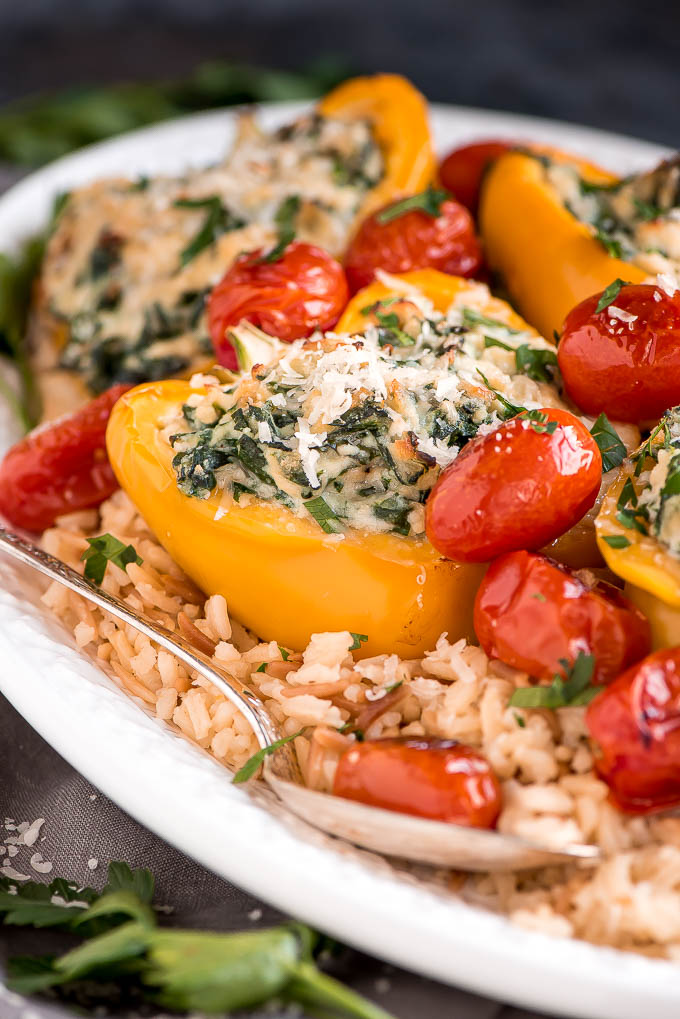 Enjoy these easy-to-make Vegetarian Spinach Ricotta Stuffed Peppers with Blistered Tomatoes for a beautiful and healthy vegetarian meal.