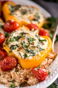 Enjoy these easy-to-make Spinach Ricotta Stuffed Peppers with Blistered Tomatoes for a beautiful and healthy vegetarian meal.