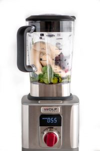 Berry Spinach Smoothie ingredients in Wold Gourmet Blender with digital timer display.