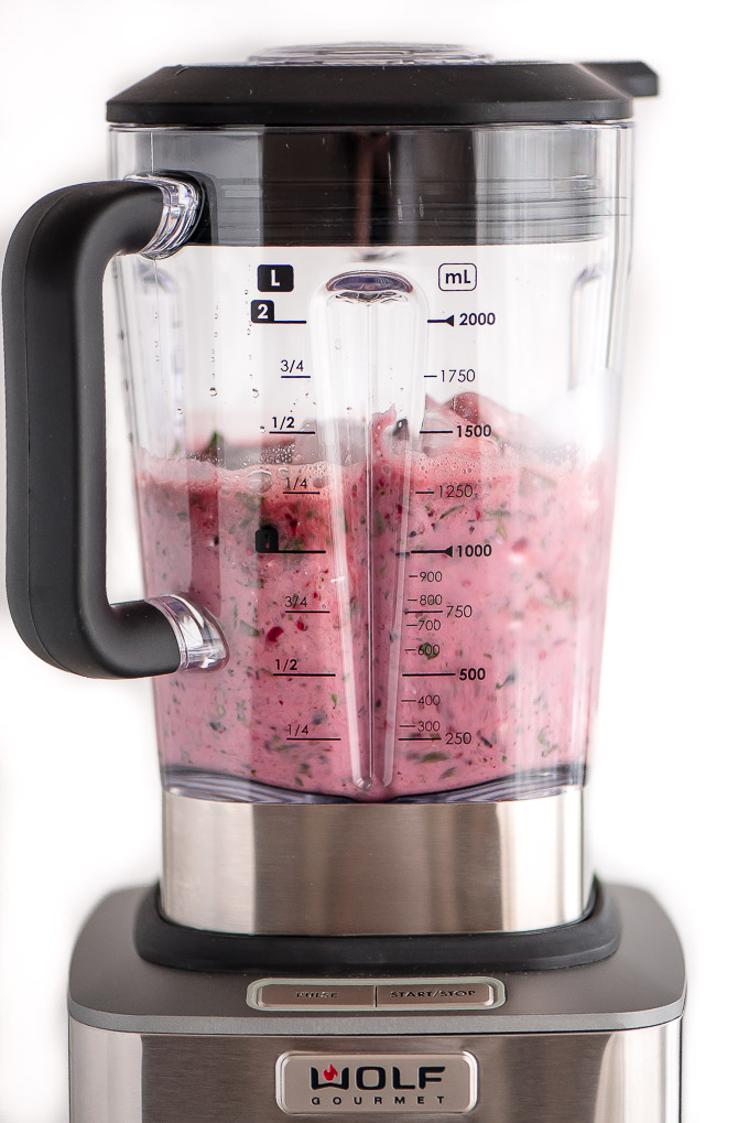 Berry Spinach Smoothie ingredients blending in Wold Gourmet Blender.