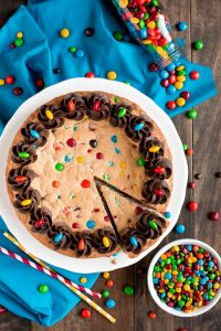 Full Chewy M&M Cookie Cake and bowl of m&m's
