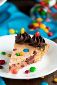 One plated slice of Chew M&M Cookie Cake