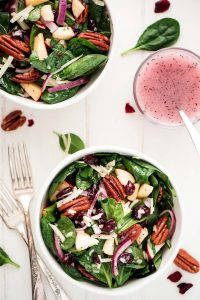 Autumn Poppy Seed Spinach Salad is the perfect side to any dinner. It's loaded with amazing toppings, good-for-you greens, and topped with the most delicious homemade poppy seed dressing.