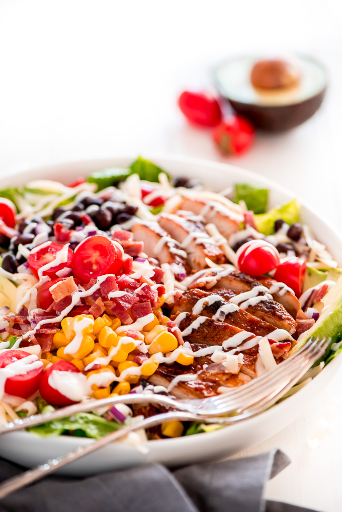 BBQ Chicken Salad with chicken, bacon, corn, tomatoes, black beans, and drizzled with ranch dressing.