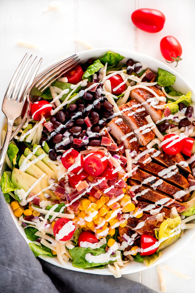 Large bowl of BBQ Chicken Salad loaded with vegetables.